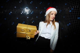 Dissatisfied woman with a golden gift