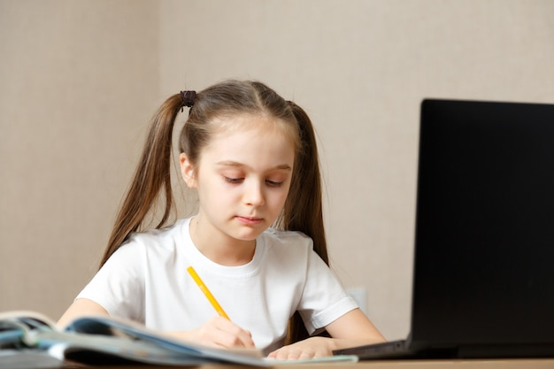 Distance learning online education. schoolgirl studying at home