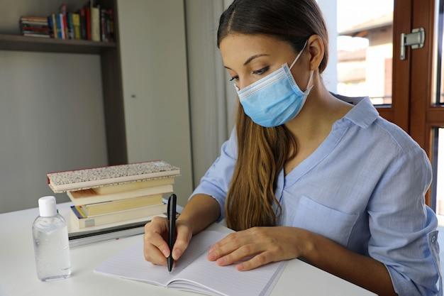 Distance learning quarantine young woman studying from home for virus disease 2019-ncov.