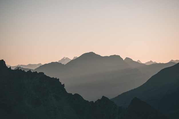Distant mountain silhouette with clear sky and soft light