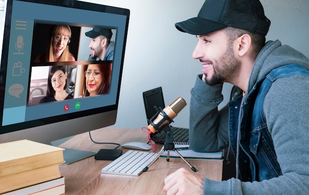 Distant videocall chat with different people. view over seated man's shoulder, remote chat