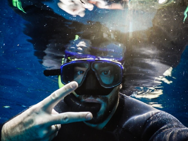 Diver posing for snorkel photo