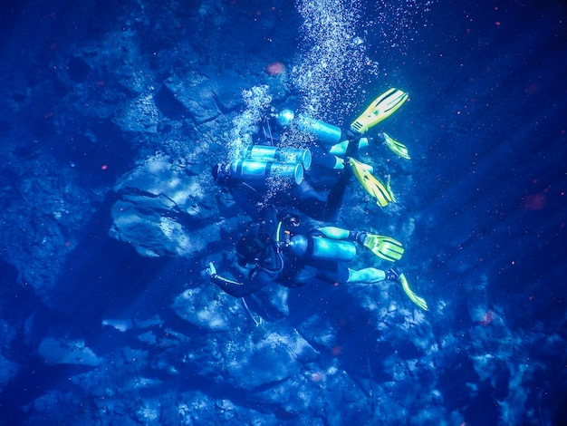 Divers in blue water lagoon