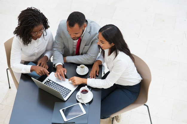 Diverse business group working on laptop