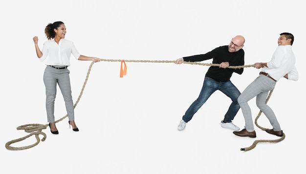 Diverse business people tugging on a rope