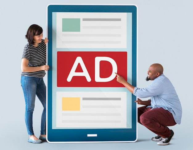 Diverse couple holding a tablet with graphics