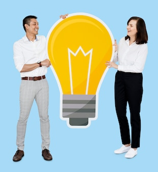 Diverse couple with a light bulb icon