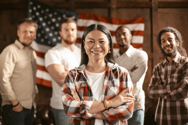 Diverse group of american patriots with american flag