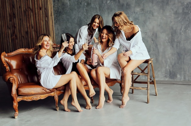 Diverse group of female friends enjoying at a party and laughing.