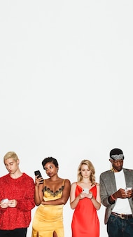 Diverse group of friends standing in a row using their smartphones