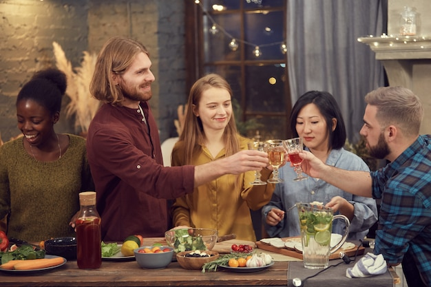 Diverse group of people toasting at party