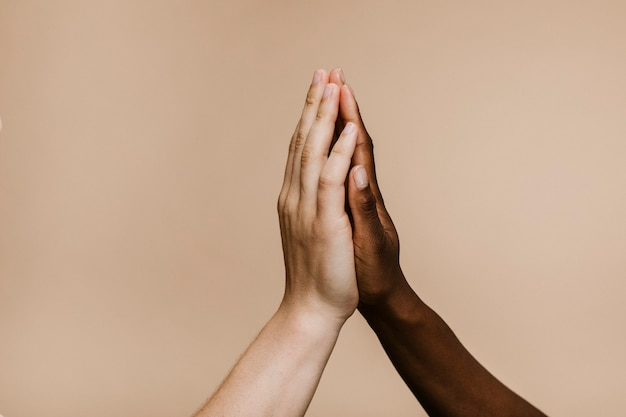 Diverse hands giving high five