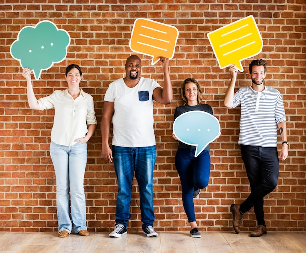 Diverse happy people holding speech bubble icons