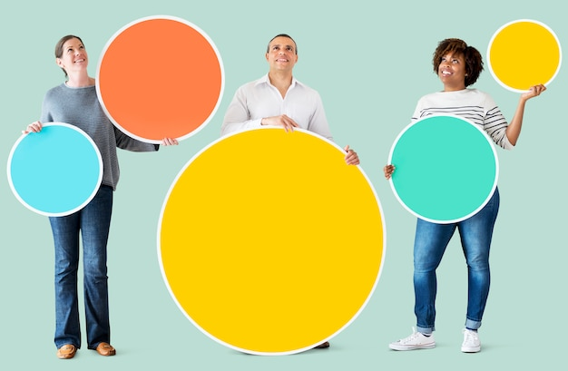 Diverse people holding colorful circles