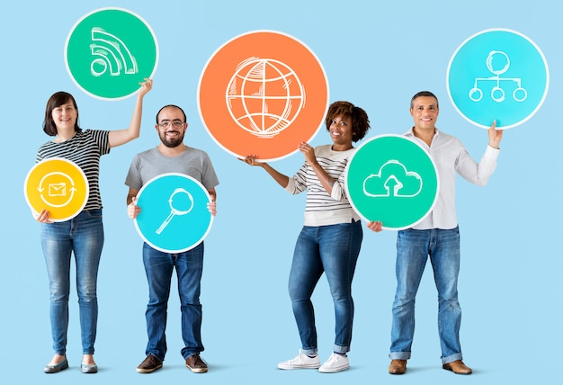 Diverse people holding technology icons