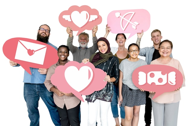 Diverse people holding valentine icons