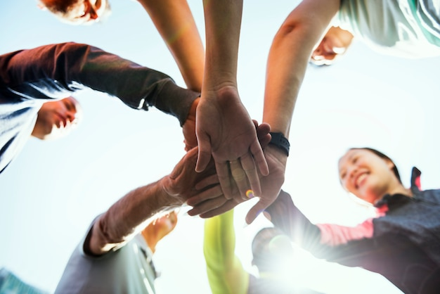 Diverse people joined hands together