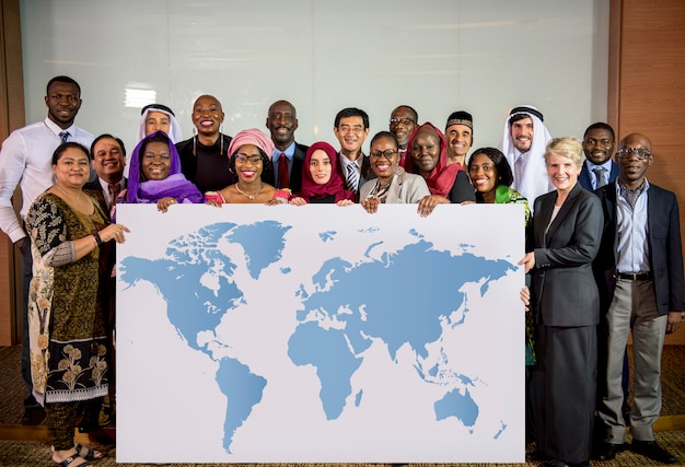 Diverse people show world map board placard