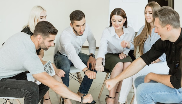Diverse people sitting in circle spread hands at group therapy session team practice