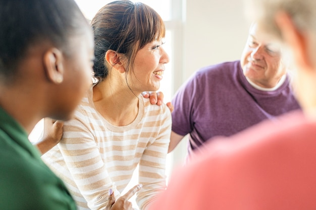Diverse people in a support group session