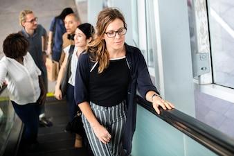 Diverse people taking an escalator