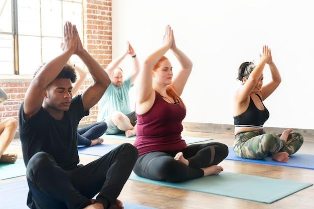 Diverse people in yoga class