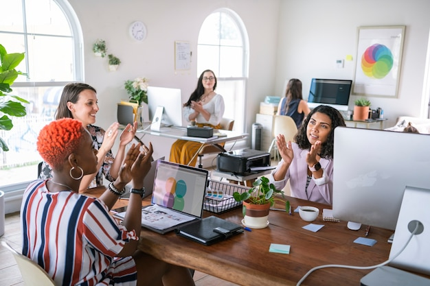 Diverse successful business team clapping
