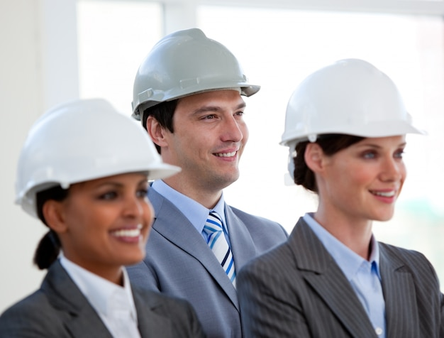 A diverse team of architects standing during at a conference