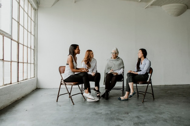 Diverse women in a  supporting group session