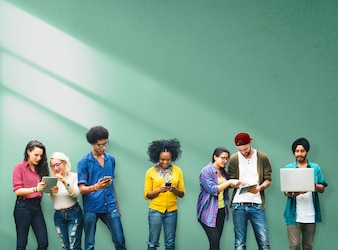 Diverse young adults using electronic devices