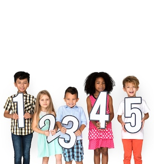 Diverse young kids holding numbers 1 - 5