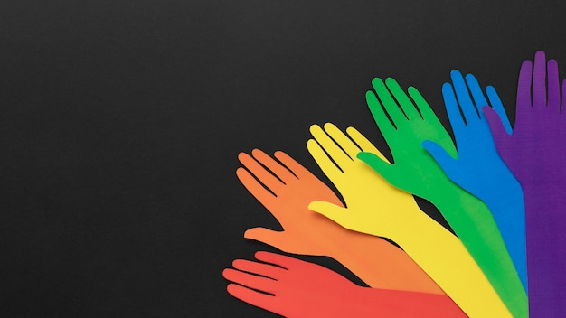 Diversity composition of different colored paper hands with copy space
