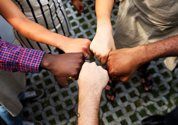 Diversity hands fist bumped together teamwork