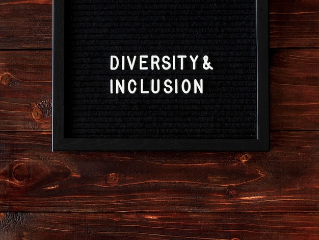 Diversity and inclusion quote on black fabric