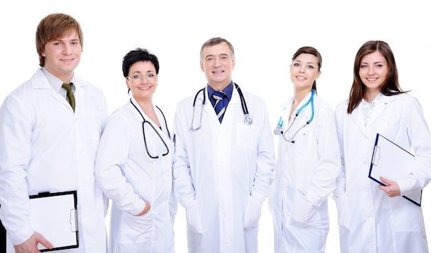 Diversity team of five happy successful doctor standing together