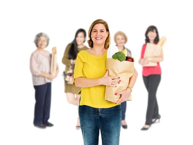 Diversity women buy food supermarket studio isolated