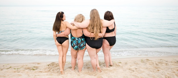 Diversity of women looking at the ocean