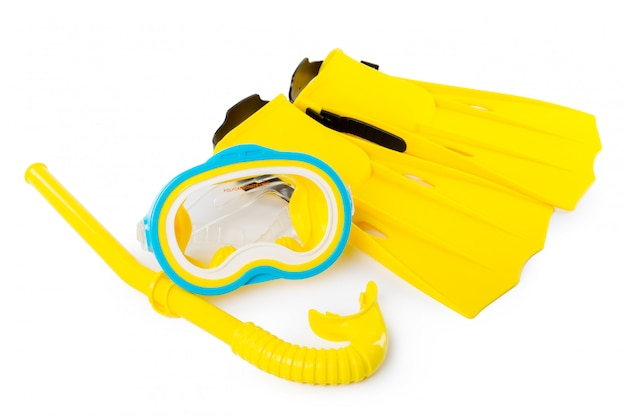 Diving equipment goggles,snorkel and flippers on white