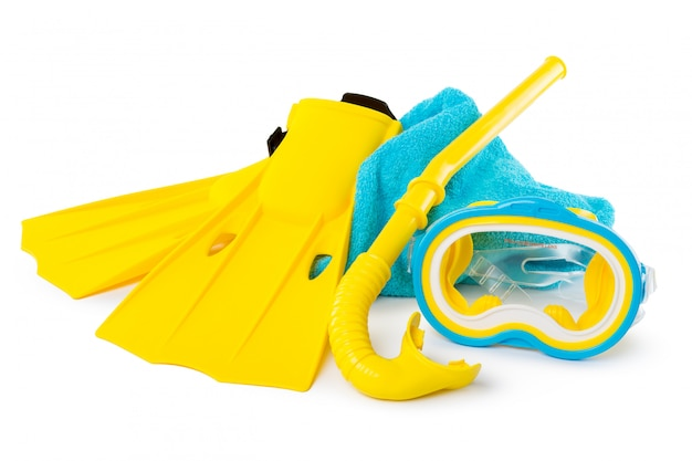 Diving equipment goggles,snorkel and flippers on white.