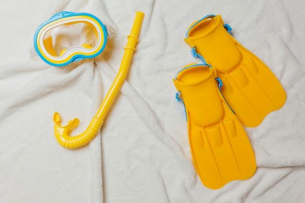 Diving equipment on white towel
