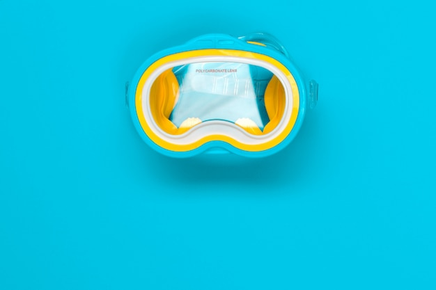 Diving goggles isolated on color background