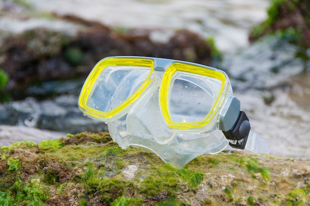 Diving mask on the rocks