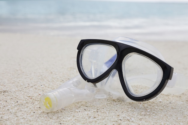 Diving mask and a snorkel on the sand