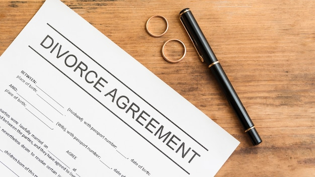Divorce agreement on wooden table