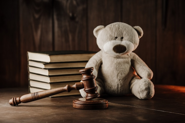 Divorce and alimony concept. wooden gavel and teddy bear as symbol of child
