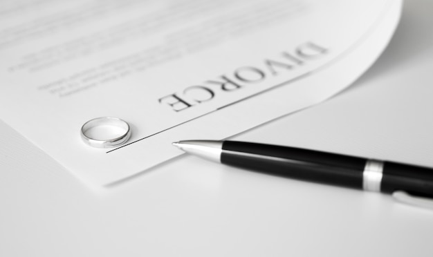 Divorce contract with rings on table