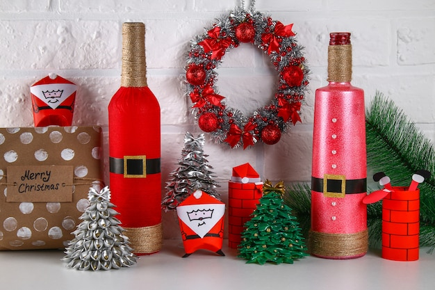 Diy bottle santa. guide on the photo how to make the decor of the bottle in the form of santa claus