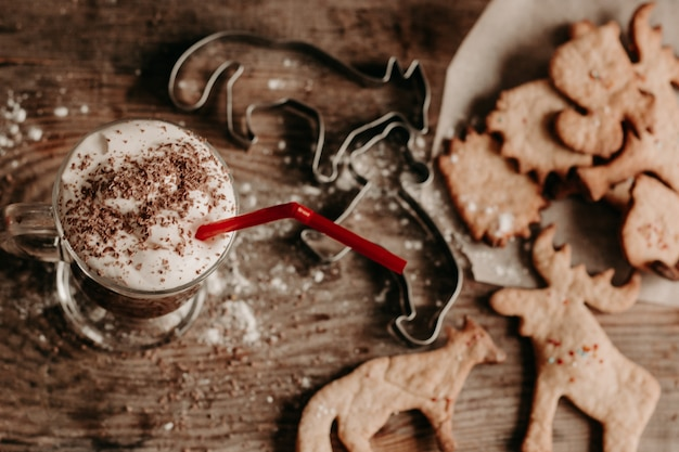 Diy christmas cookies. hot chocolate with cream and biscuits. animal figurine cookies
