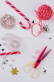 Diy christmas decorations concept. flat lay composition of tools and decorations for christmas craft. easy christmas decorations ideas.