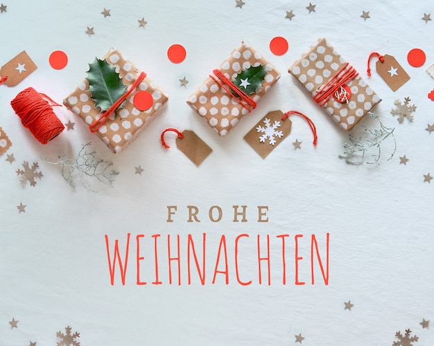 Diy christmas gifts and handmade decorations, flat lay with frohe weihnachten inscription